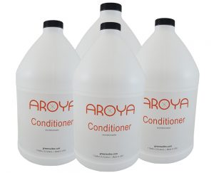 Four bottles of Aroya Conditioner used as bulk hotel amenities.