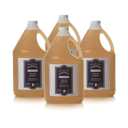 Four bottles of Beekman 1802 Dispensary Body Wash to be used as hotel amenities.