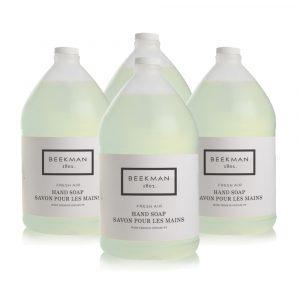 Four bottles of Beekman 1802 Fresh Air Hand Soap.