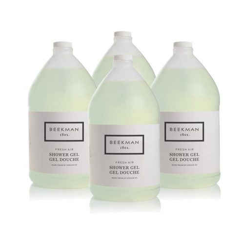 Four bottles of Beekman 1802 Fresh Air Shower Gel for use in hotel amenity dispensers.