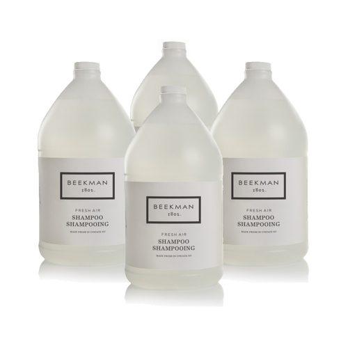 Four bottles of Beekman 1802 Fresh Air Shampoo used as hotel amenities.