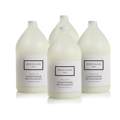 Four bottles of Beekman 1802 Fresh Air Conditioner used as hotel amenities.