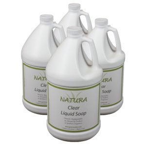 Four bottles of Natura Clear Liquid Soap used for hotel amenities.