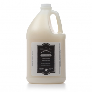 A bottle of Beekman 1802 Conditioner for hotel amenities.