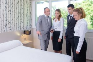 Group of staff and management go over hotel operations